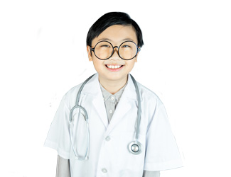 A smiling child dressed as a doctor