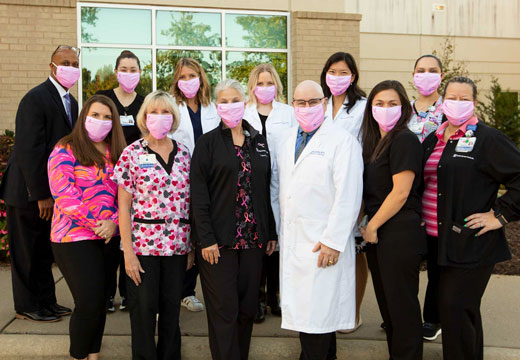 Providers wear pink masks for breast cancer awareness