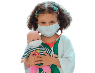 A child dressed up like a doctor holding a doll, both with masks on