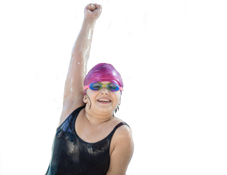 A girl cheers as she pops out of a pool
