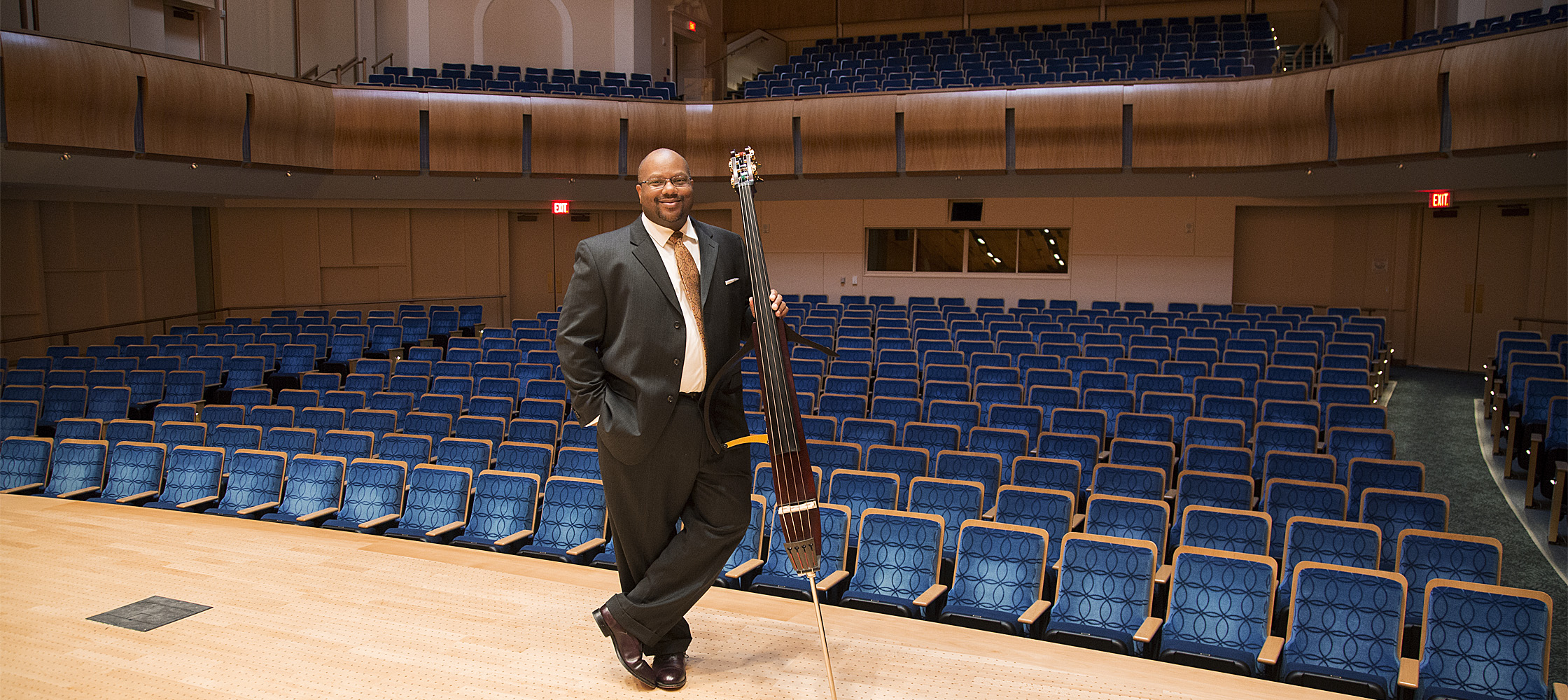 Brown with his bass on stage at the Baldwin Auditorium on Duke University's campus.