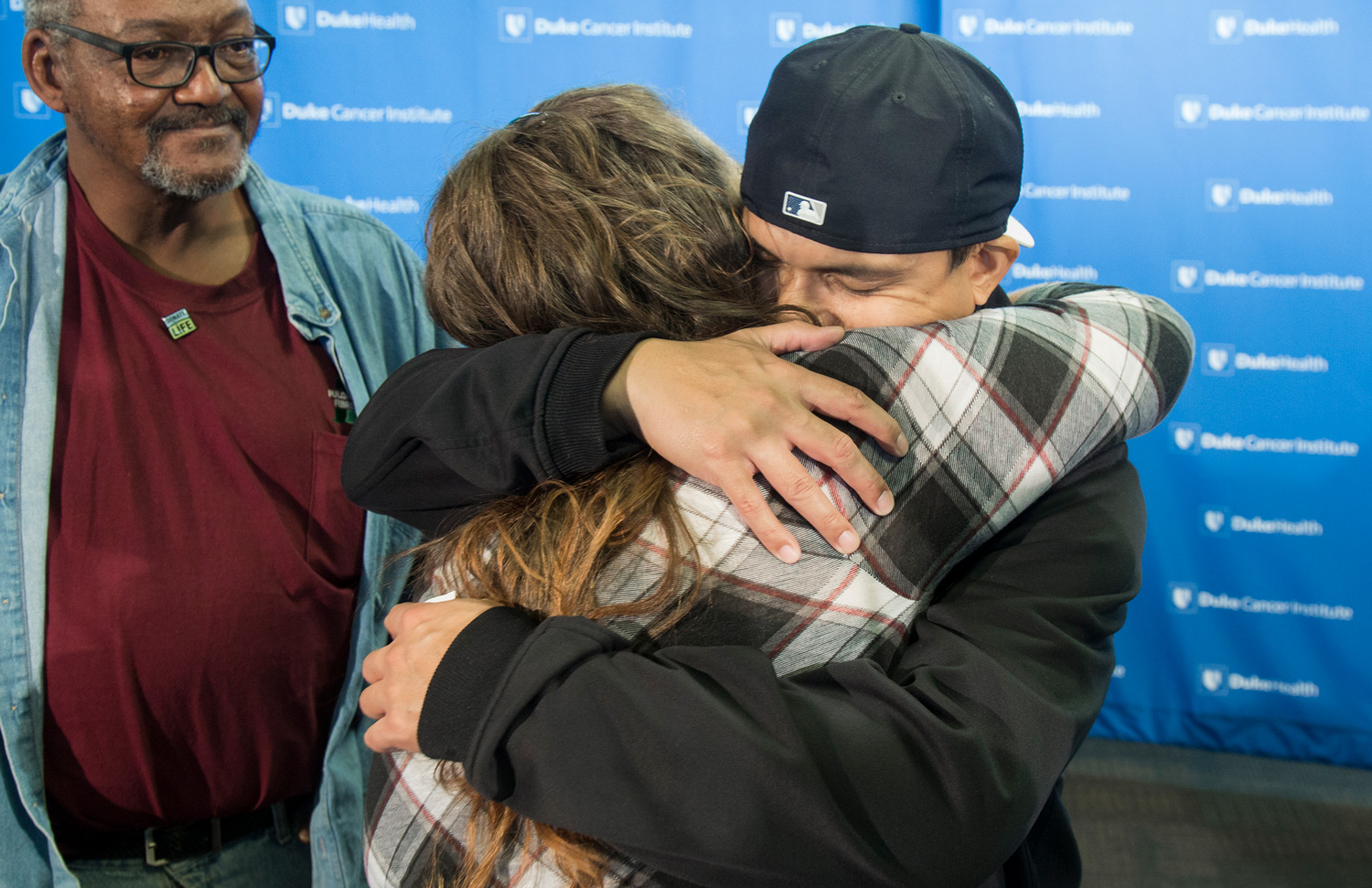 A recipient hugs the mother of his donor