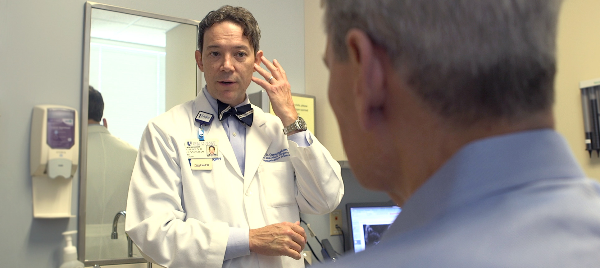 Dr. Calhoun Cunningham, MD, speaks with a patient about skull base tumor treatment options.