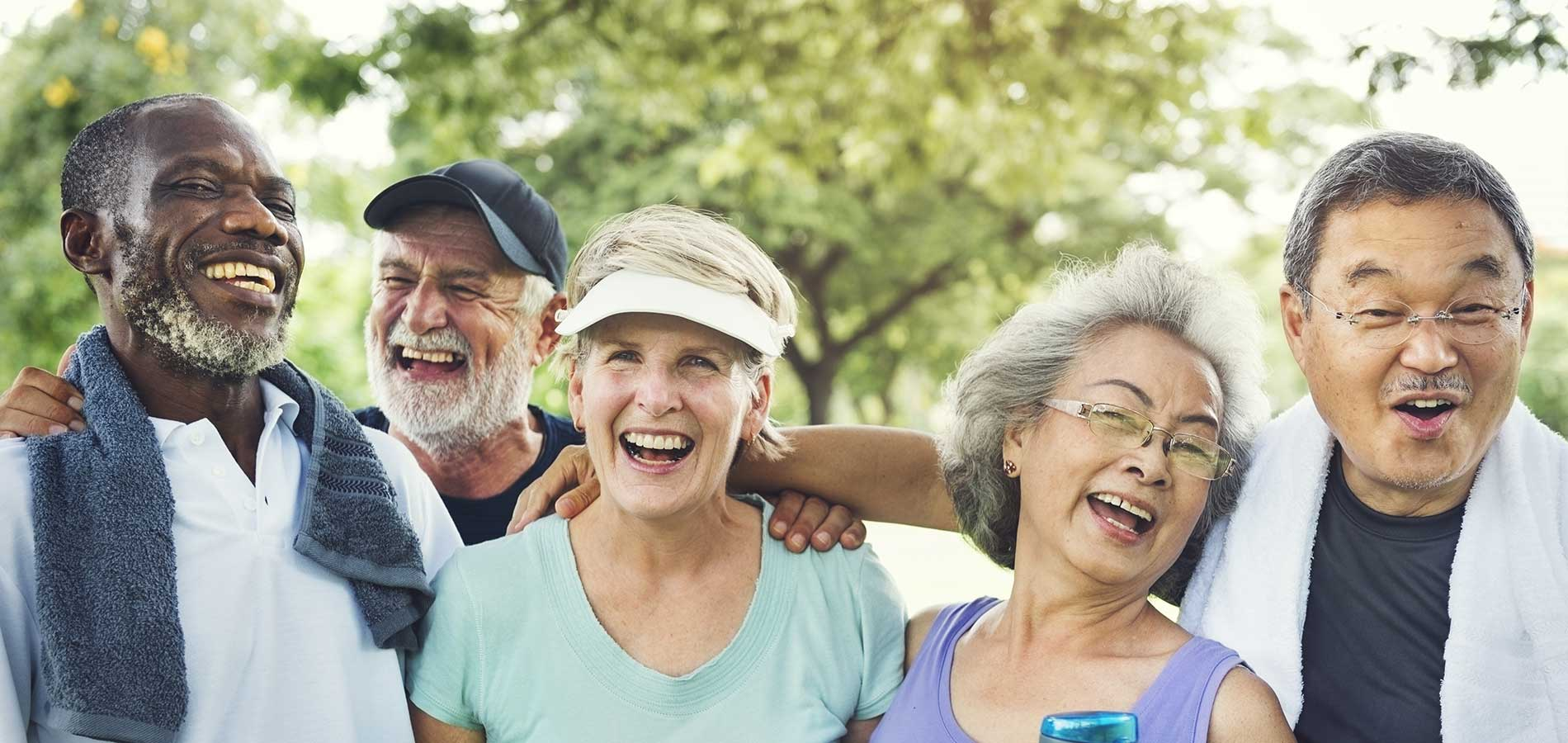 A group of older adults smile