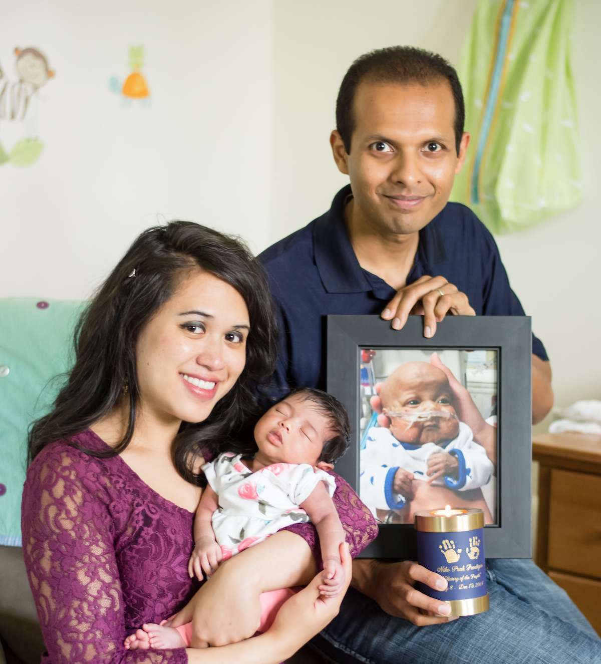 Family portrait with a photo of Niko (Linsley Schneider Photography)