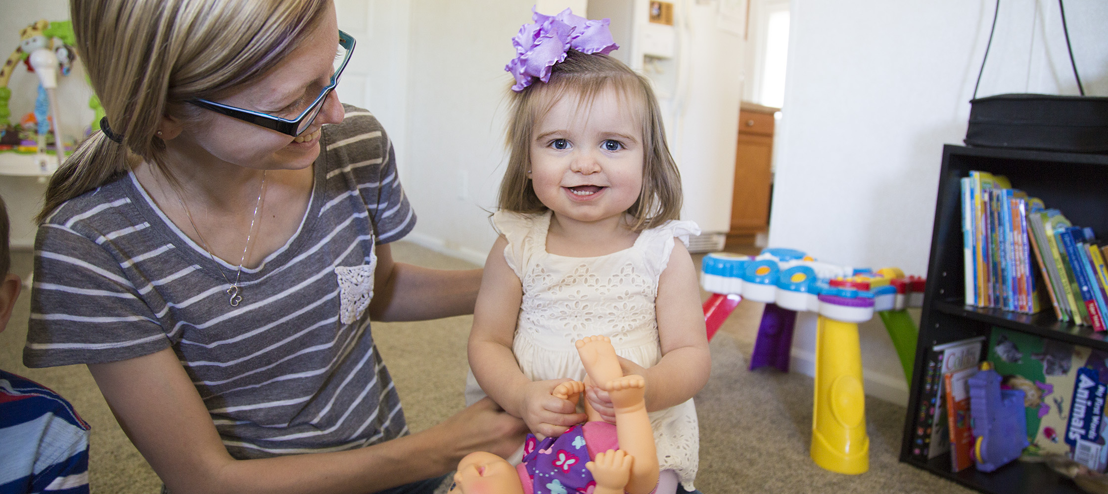 Paisleigh Hamilton plays with her mom, Melissa, at their home in Kinston.