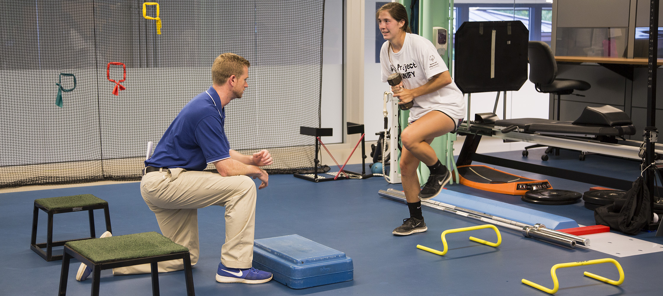 Jesse von Arx works with Duke physical therapist Patrick Chasse.