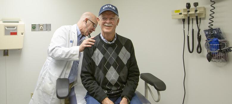 A provider examines a patient
