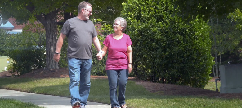 Patient walking with his wife after ankle surgery