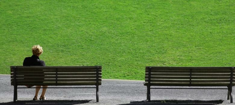Woman sitting on a bench alone