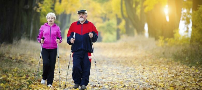 An older couple walking on a trail