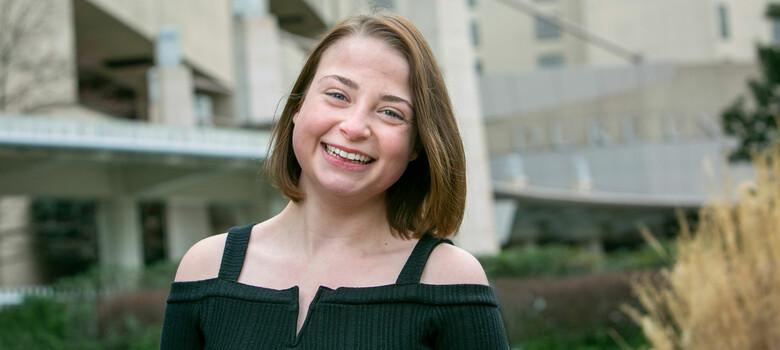 Josie Dunnigan smiles outside of Duke University Hospital.