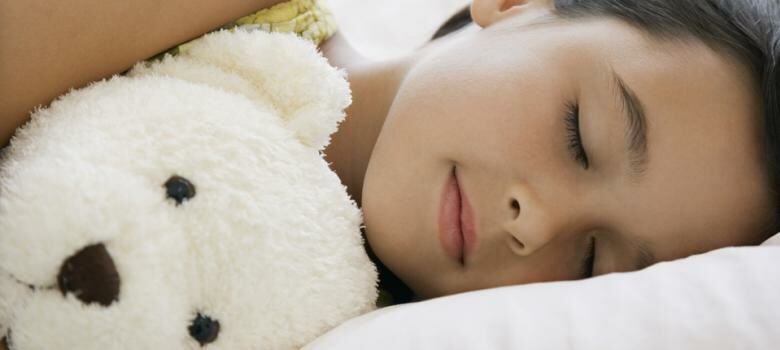 Sleeping child with a stuffed animal