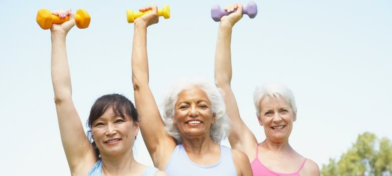 group of older women lifting weights