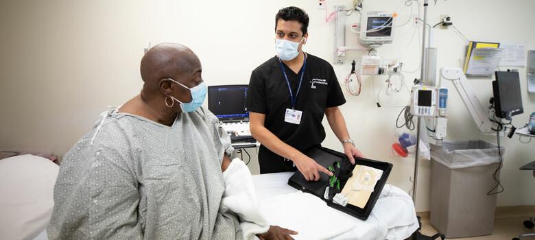 A provider shows a patient a PNS device