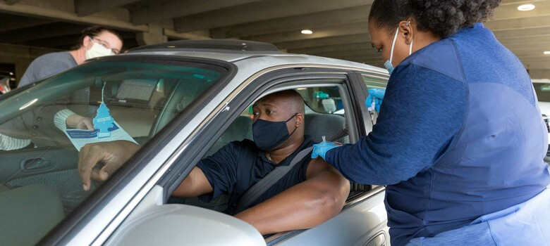 Duke provider administers J&J COVID-19 vaccine at drive-through clinic.