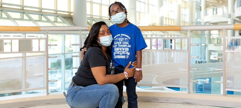 A mom and her son pose for a photo in the hospital