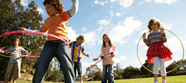 Children hoola hooping outside
