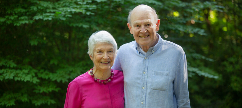 Margaret and Richard Hodel stand in the back yard of their home in Durham, NC.