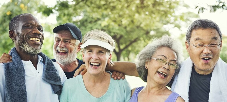 A group of older adults laugh together