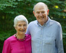 Margaret and Richard Hodel stand in the backyard of their home in Durham, NC.