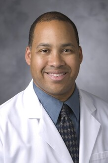 Andre E. Bell, MD
