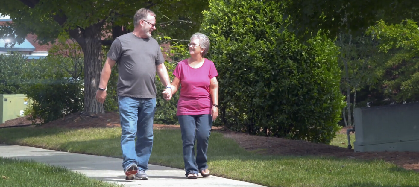 Patient walking with wife after ankle surgery
