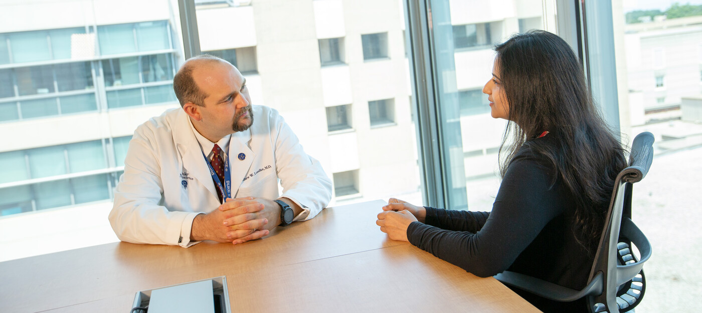 A provider speaks with a patient