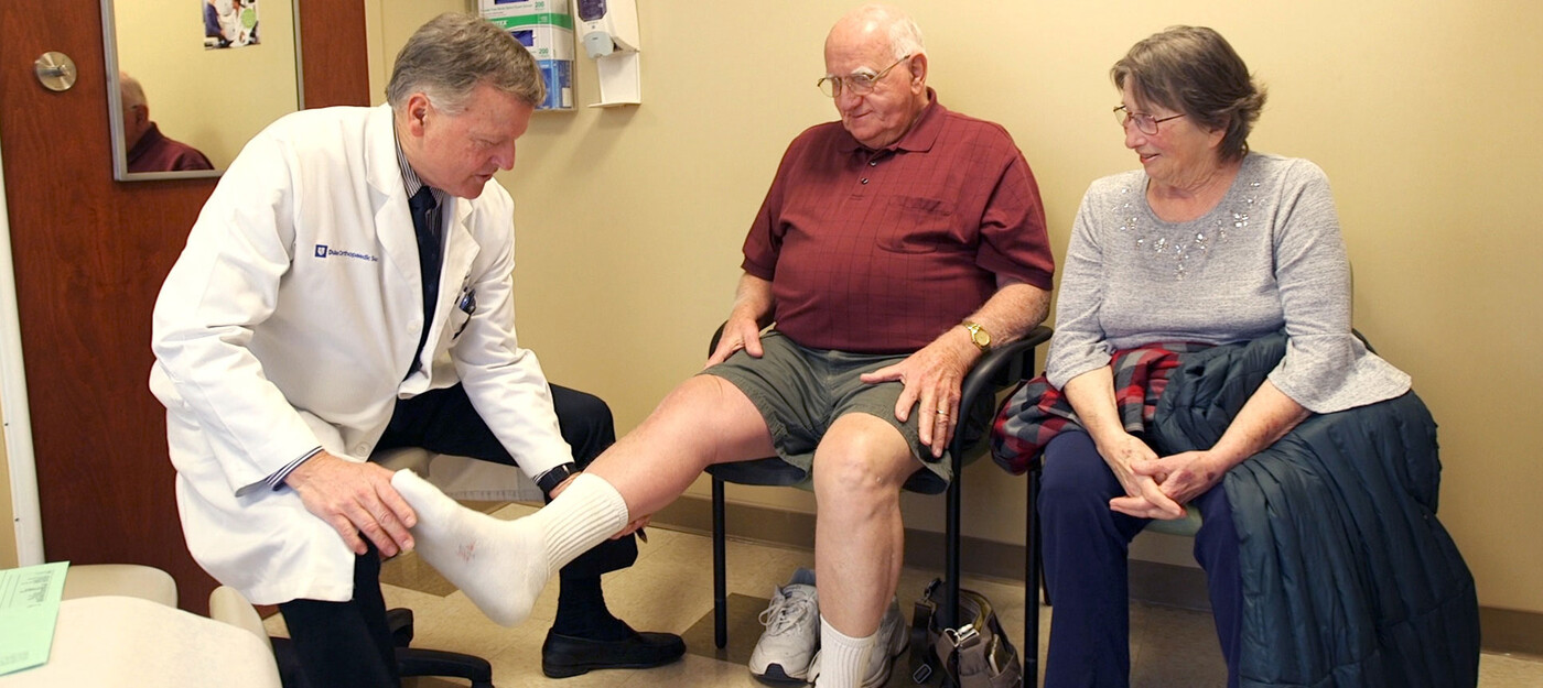 A provider looks at a patient's knee