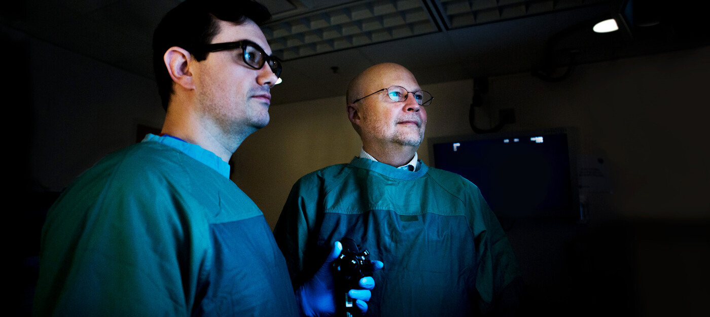 Darin Dufault, MD, and Stan Branch, MD, pose together with a scope.