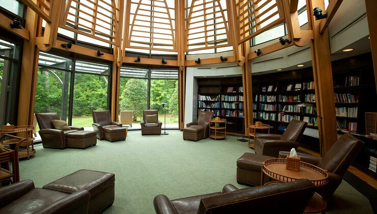 Our circular library features relaxing, leather seating, and a soaring cathedral ceiling.