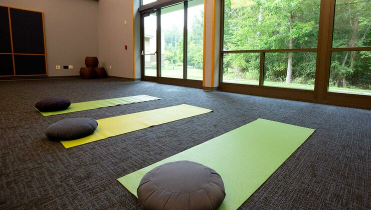 Several yoga mats lined up for a yoga session at Duke Integrative Medicine.