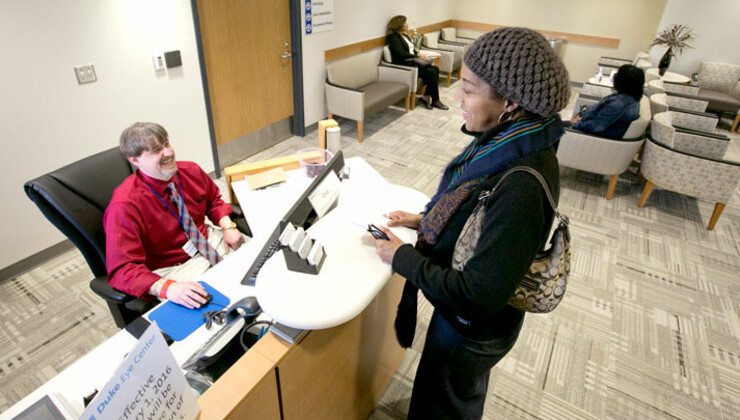 Woman checking in to Eye Center