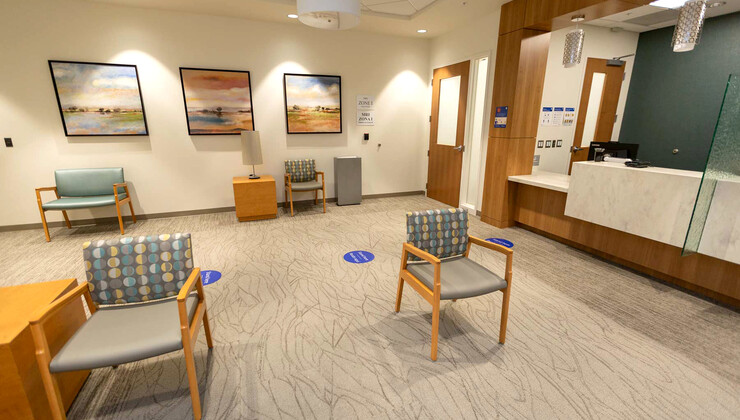 The waiting room and check-in desk at Duke Health Holly Springs Radiology.