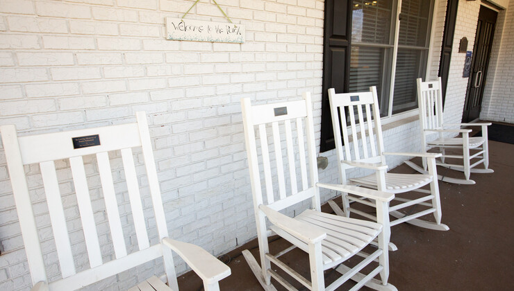 Rocking chairs on the front porch of Hock Family Pavilion.