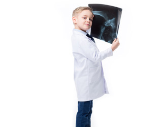 A child holds up an x-ray